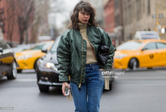 NEW YORK, NY - FEBRUARY 15: Irina Lakicevic wearing a green bomber jacket seen outside Tommy Hilfiger during New York Fashion Week: Women's Fall/Winter 2016 on February 15, 2016 in New York City. (Photo by Christian Vierig/Getty Images) *** Local Caption *** Irina Lakicevic